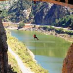 Hanging from the Caminito del Rey Bridge